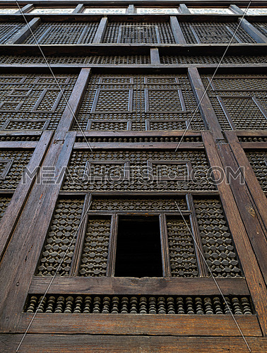 An Original Mashrabiya facade at the inner courtyard of one of the historic houses in Old Cairo, Egypt