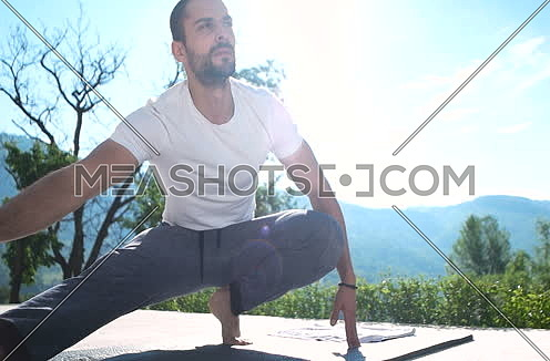 man doing exercise in front of villa