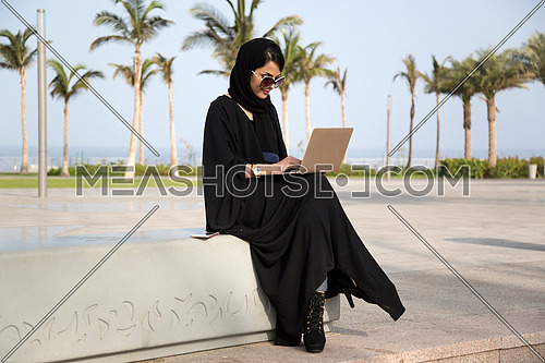 Arab lady working in public