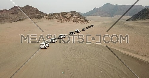 Drone shot for trucks off roading in the desert at day