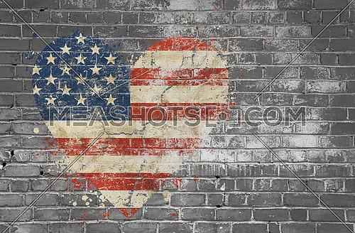 Grunge distressed heqart shaped flag of USA painted on old weathered grey brick wall