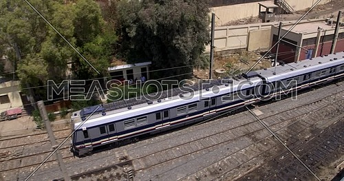 Chase Shot from Drone for Metro starting to move in cairo at day