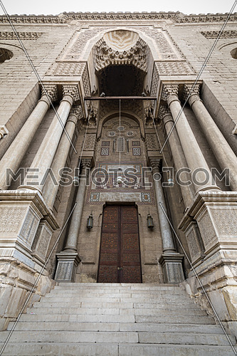 Entrance leading to a Al Rifaii mosque with Stairs and wooden closed door, Cairo, Egypt