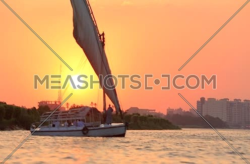 Mid-shot for the River Nile and a feluka at sunset in Cairo