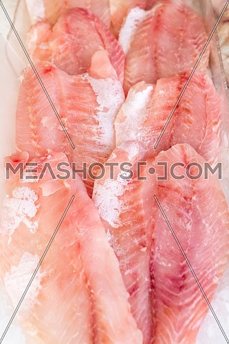 African perch fillet on ice at seafood market,healthy life concept, diet.