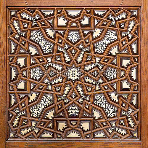 Closeup of arabesque ornaments of an old aged decorated wooden door, Al Rifaii Mosque, Old Cairo, Egypt