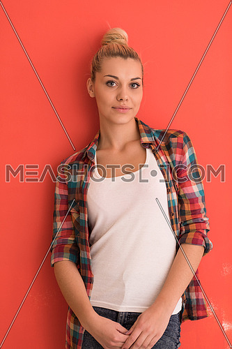 Portrait of a beautiful  young woman with hair bun over color background with copyspace expressing different emotions