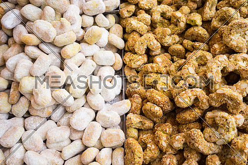 Background of typical sicilian cookies,pastries, made with  almond paste for sale in italian market.