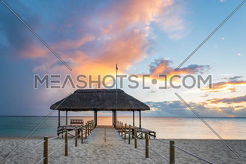 Panoramic footbridge over the indian ocean, Amazing flic en Flac beach at sunset,Mauritus island,Africa.