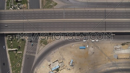 Aerial shot flying over Juhayna Bridge at 6th of October City during the corona pandemic lockdown by day 10 April