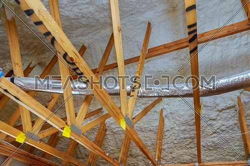 New home construction with installation of heating system on the roof of house attic under construction