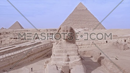 Fly over Shot Drone for The Sphinx and Menkaure Pyramid and Khafre Pyramid in Giza at day