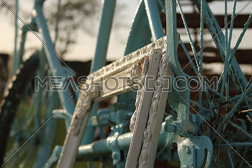 white wooden frame resting on a blue bicycle