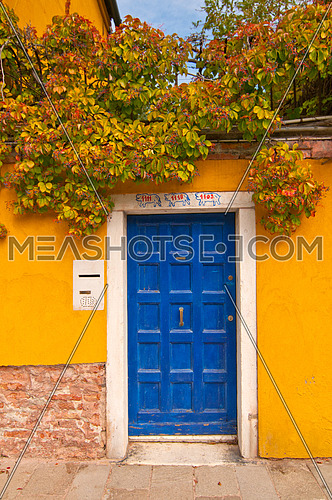 A blue door in the streets of venice