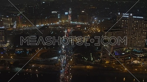 Fly over Trahrir Sqaure showing Traffic, Kasr El Nile Bridge and The Rivir Nile at night - Novermber 2018