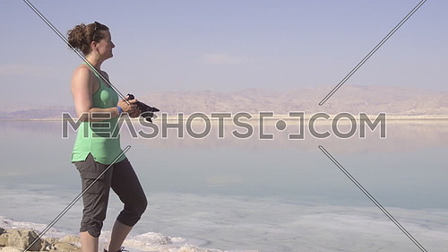 View of woman photographing the Dead Sea
