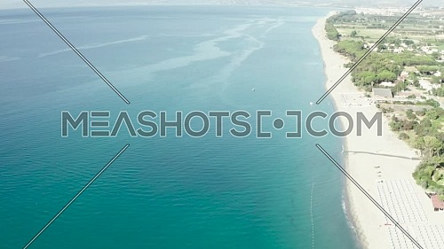 Aerial view of beautiful mediterranean sea and beach at sunny day, seascape and hill mountain on backgrond, Simeri Mare, Calabria, Southern Italy