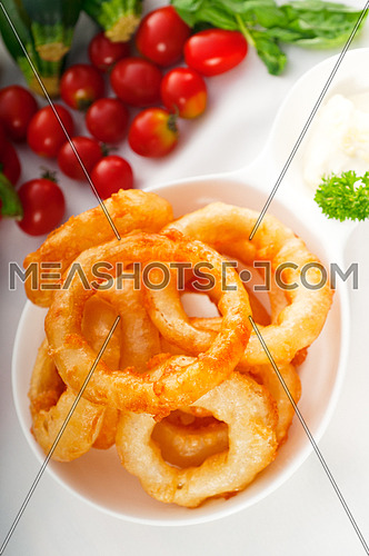 golden deep fried onion rings served with mayonnaise dip  and fresh vegetables oln background ,MORE DELICIOUS FOOD ON PORTFOLIO