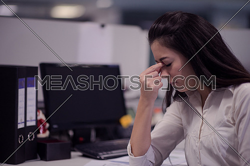 stressed busienss woman at workplace