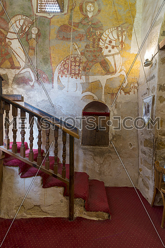 Cairo, Egypt - March 24 2018: Wall with Coptic fresco paintings and staircase leading to the Church of St. Paul & St. Mercurius, Monastery of Saint Paul the Anchorite (aka Monastery of the Tigers), Egypt