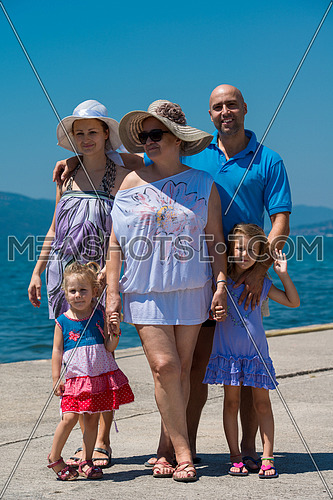 Portrait of happy multi generation family holding their hands while standing on the beach coast during Summer vacation Healthy family lifestyle concept