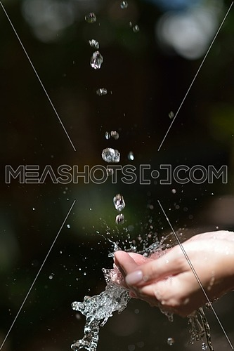 beauty and spa fresh water stream on woman hand