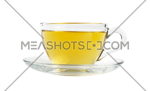 Close up one transparent glass cup of green oolong or herbal tea on saucer isolated on white background, low angle side view