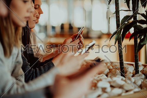 macro photo of young people using the phone during a break from work