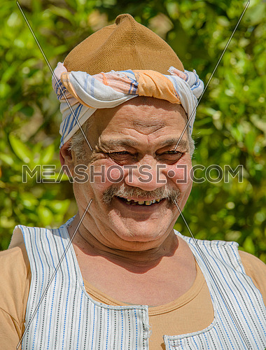 a portrait of an egyptian farmer smiling