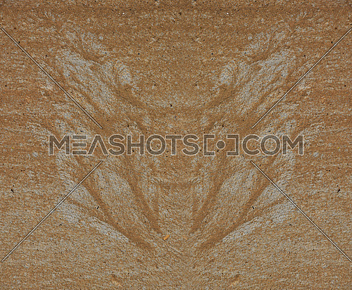Silhouette of butterfly wings made of sand and gravel by water flow at concrete surface