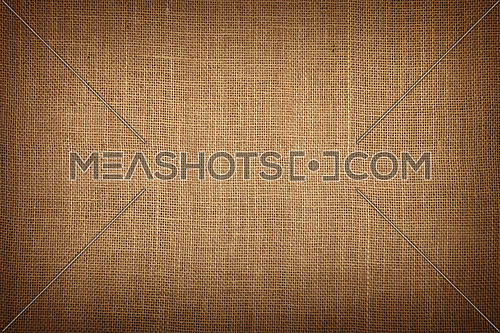 Natural brown burlap jute sackcloth bagging canvas texture pattern background with dark shade border