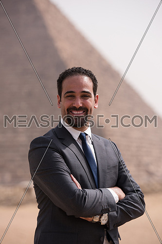 portrait of handsome middle eastern man in egyptian  desert