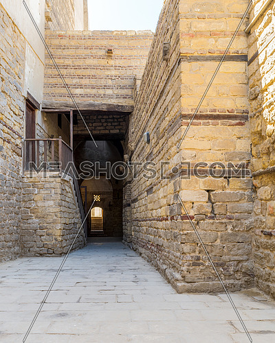 Exterior daylight shot of old abandoned stone bricks passage surrounding Sultan Qalawun Complex located in Al Moez Street, Cairo, Egypt