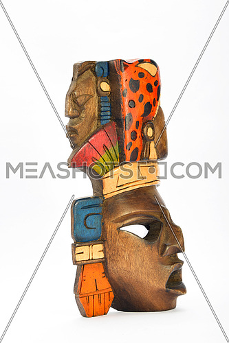 Indian Mayan Aztec wooden painted mask with roaring jaguar and human profiles isolated on white background