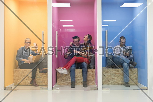 group of young business people having fun, relaxing and working in creative room space at modern startup office