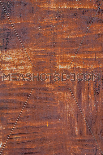 Bright rust stained corroded metal surface with uneven paint