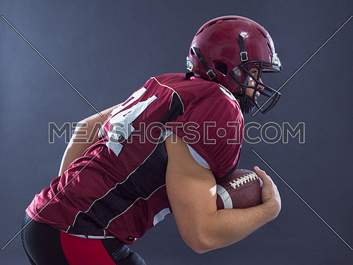 American football Player running with the ball isolated on a gray background