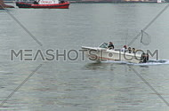 Small motor boat in harbor