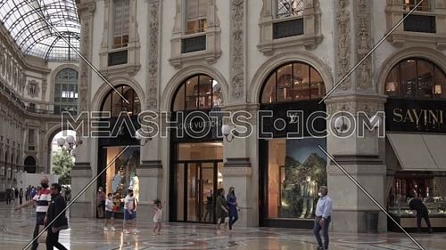 Milan, Italy - June 6, 2021: Louis Vuitton official shop inside Vittorio Emanuele II gallery, near Duomo Cathedral.