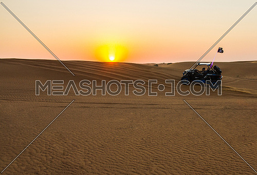 desert buggy running on the desert dunes