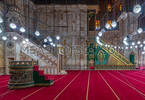 Engraved marble alabaster platform (Minbar) and wooden green decorated platform at the great Mosque of Muhammad Ali Pasha (Alabaster Mosque), situated in the Citadel of Cairo in Egypt