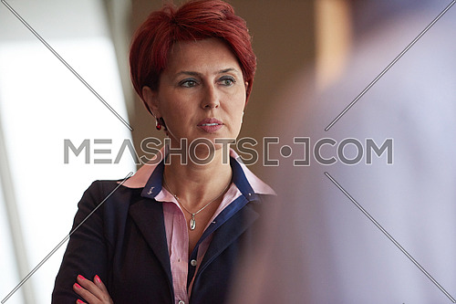 portrait of red hairstyle senior  business woman portrait at corporate office interior