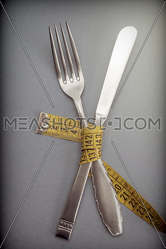 Holder and knife held by one meter, concept of diet