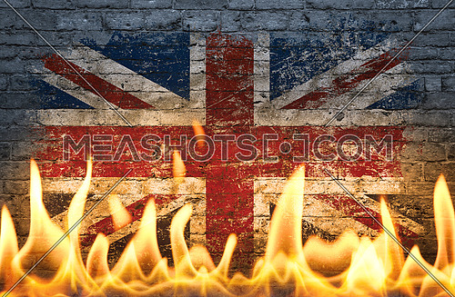Close up wall with painted British UK flag in flames as symbol of world on fire, danger, political, economic crisis or pandemic
