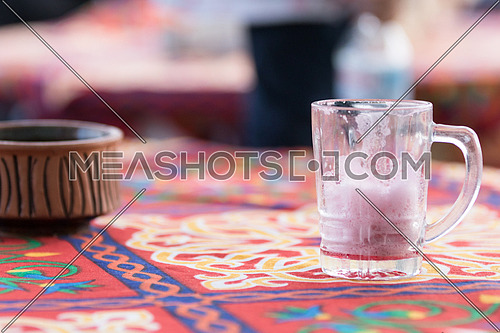 empty glass of hibiscus on table