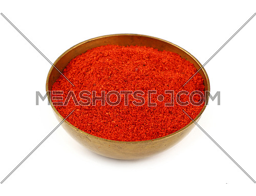 Close up one bronze metal bowl full of red chili pepper or paprika powder isolated on white background, high angle view