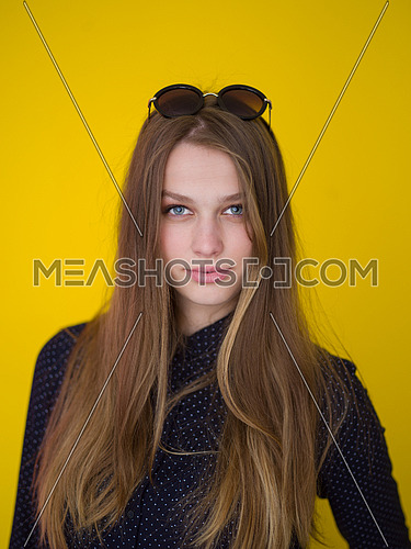 portrait of Beautiful young woman isolated on yellow background