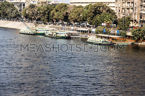a photo for the river Nile in Cairo showing the river buses port , Egypt