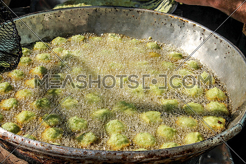 A photo showing falafel or tameya being cooked in the traditional Egyptian way