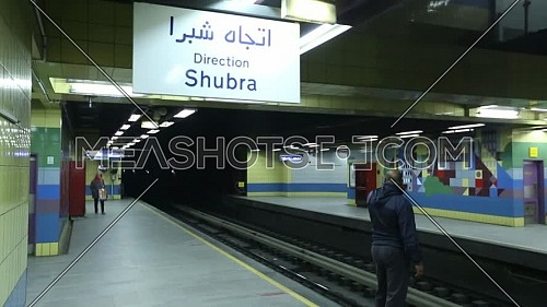 Fixed shot inside Metro Station for people walking on platform at Cairo